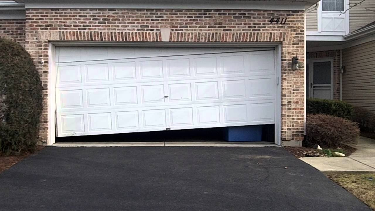 crooked-off-track-garage-door-broken-repair